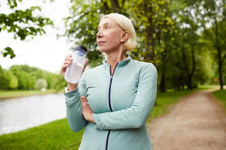 Sportswoman with bottle of water Reklamní fotografie