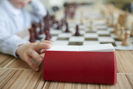 Hand pressing chess clock