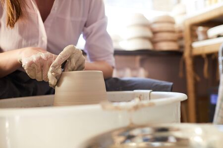 Woman Using Potters Wheel Closeup Imagens