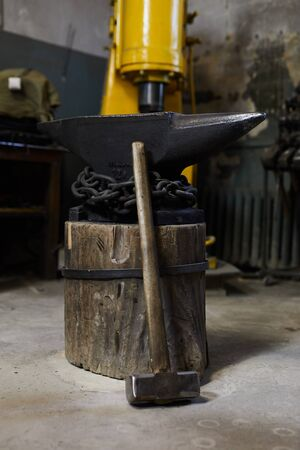 Sledgehammer and metal anvil