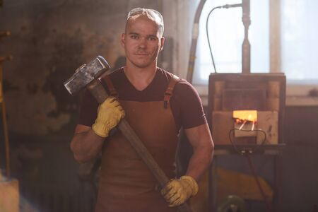 Handsome worker with sledgehammer