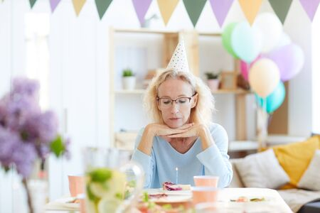 Sad woman celebrating birthday alone