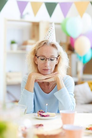Depressed lady in party hat