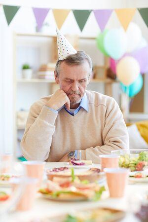 Boring senior man thinking about wish