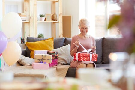 Lady opening gift box Stok Fotoğraf