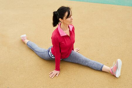 Mature Woman doing Splits