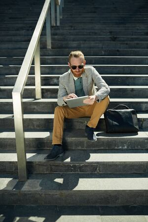 Hipster businessman working outside
