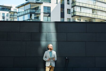 Businessman finding inspiration in city