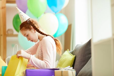 Red Haired Girl Opening Presents Stock Photo
