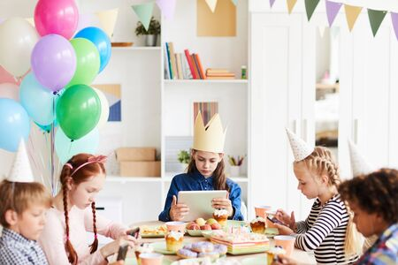 Kids Using Gadgets at Party
