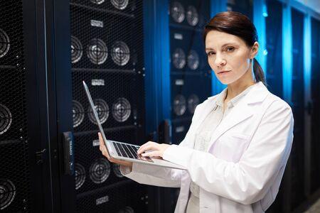 Data server technician in lab coat Stock Photo