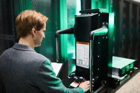Maintenance engineer repairing supercomputer