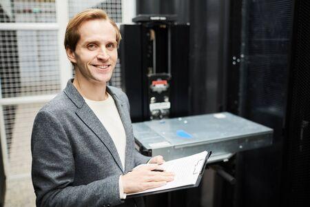 Confident computer technician in server storage room