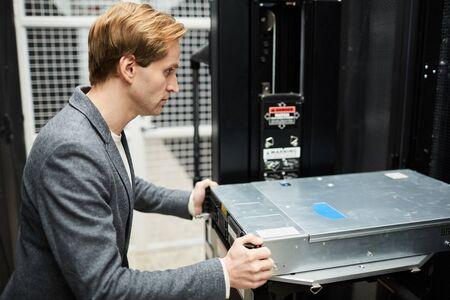 Installing powerful hard drive into supercomputer Stock Photo