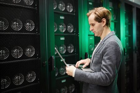 IT engineer doing cryptocurrency mining