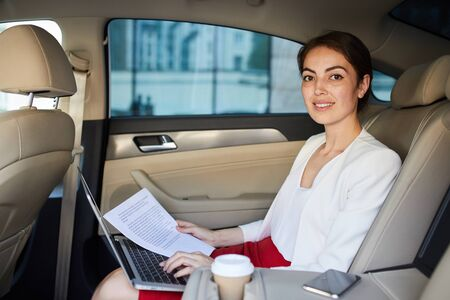 Businesswoman Posing in Taxi Imagens