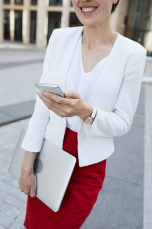 Smiling Businesswoman Holding Phone