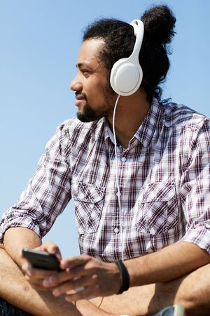Contemporary Man Listening to Music in Summer
