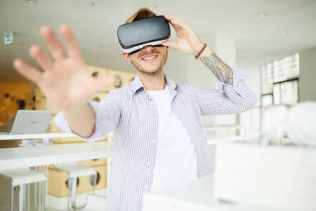 Curious hipster guy immersed into virtual world