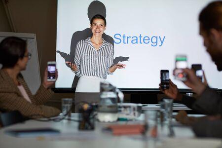 Lady conducting strategic planning meeting Banco de Imagens