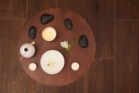 Above view background of round wooden table set for aromatherapy in SPA, copy space