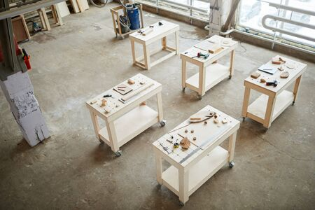 Above view wide angle background of workstations in industrial woodworking shop, copy space