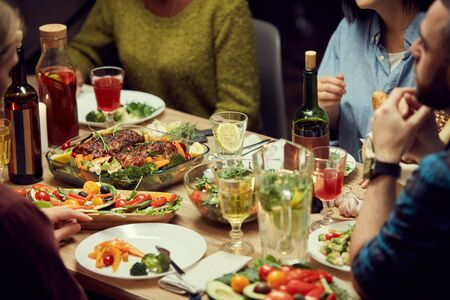Cropped image of delicious homemade food at dinner table during house party, copy space