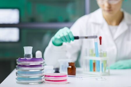 Background image of various glassware and equipment on workstation in medical laboratory, copy space Фото со стока