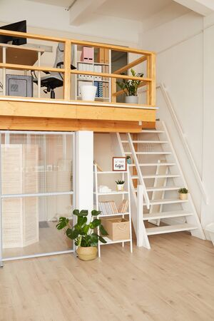 Vertical background image of modern two level apartment with minimal design and wooden details, copy space