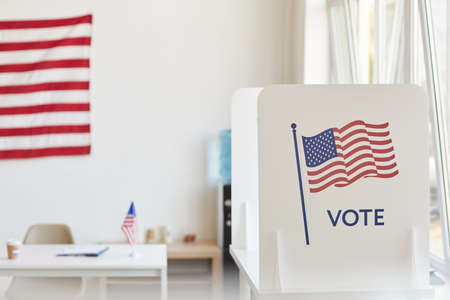 Background image of voting booths decorated with American flags at empty polling station, copy space Zdjęcie Seryjne