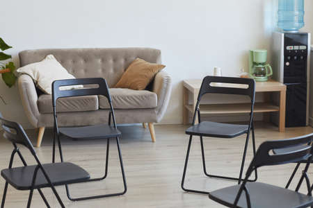 Background image of empty chairs in circle ready for therapy session or support group meeting, copy space 写真素材