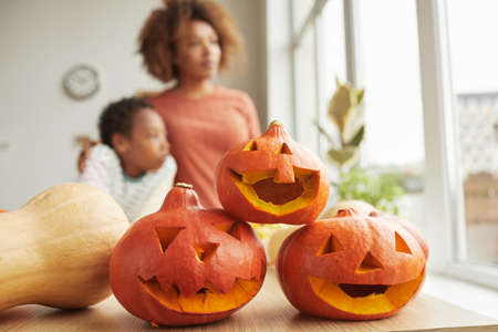 Close-up shot of three orange pumpkins prepared for modern family Halloween party at home, copy space 写真素材