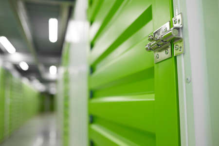 Close up background image of storage facility with focus on lock latch on container door, copy space Stockfoto