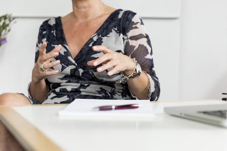 repel: Hands (woman) gesturing in conversation  Stock Photo