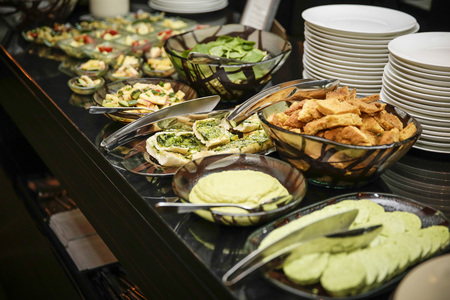 Appetizer buffet with salad and bread and plates photo