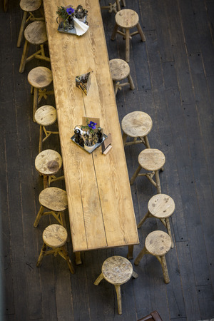 stools: Stools in restaurant with wooden table from above Stock Photo