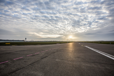 runway: Airport runway and airfield at sunrise Stock Photo