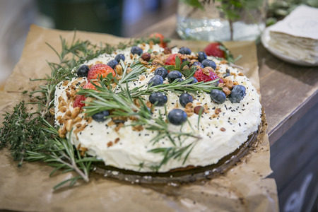 carrot cake: Carrot cake with icing and berries