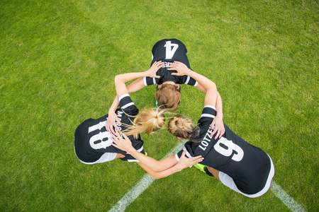 huddle: Womens Soccer Team Meeting Huddle Stock Photo