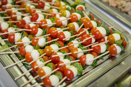 Tomato and mozzarella skewers at the buffet  catering 写真素材