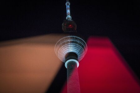 Fernsehturm Berlin at night with reflections