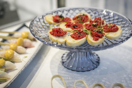 Bruschetta on bread with gold leaf  catering