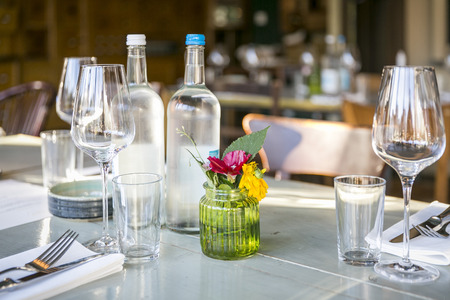 Restaurant  decoration with flower vase, cutlery and crockery