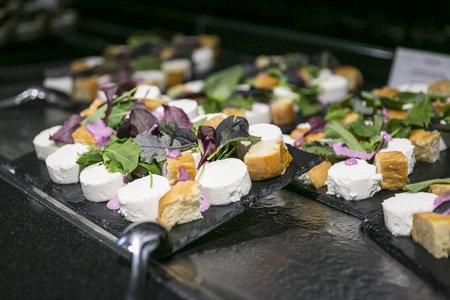Catering & buffet  goats cheese with salad on slate plate 写真素材