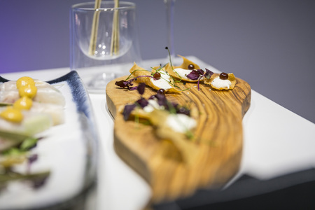 Catering / appetizer served on wooden board
