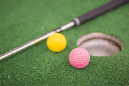 Mini golf with balls, racket and hole