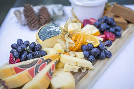 Catering, buffet and finger food / cheese plate with fruit