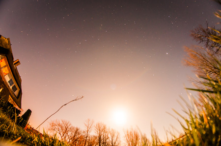 cope: A glowing moon and stars in the night cope. Stock Photo