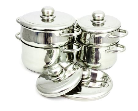 Pans made of stainless steel on a white background