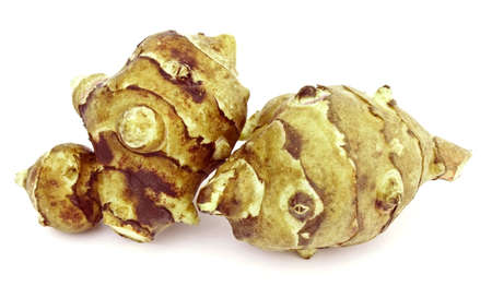 Two tubers of jerusalem artichoke on white background Stock Photo